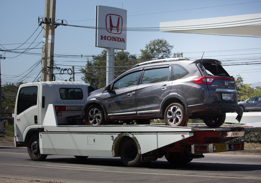 a gray car on the towing truck